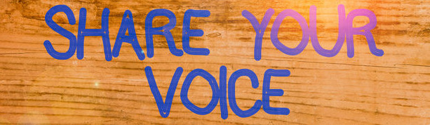 Handwriting text Share Your Voice placed above a wooden classic table backdrop